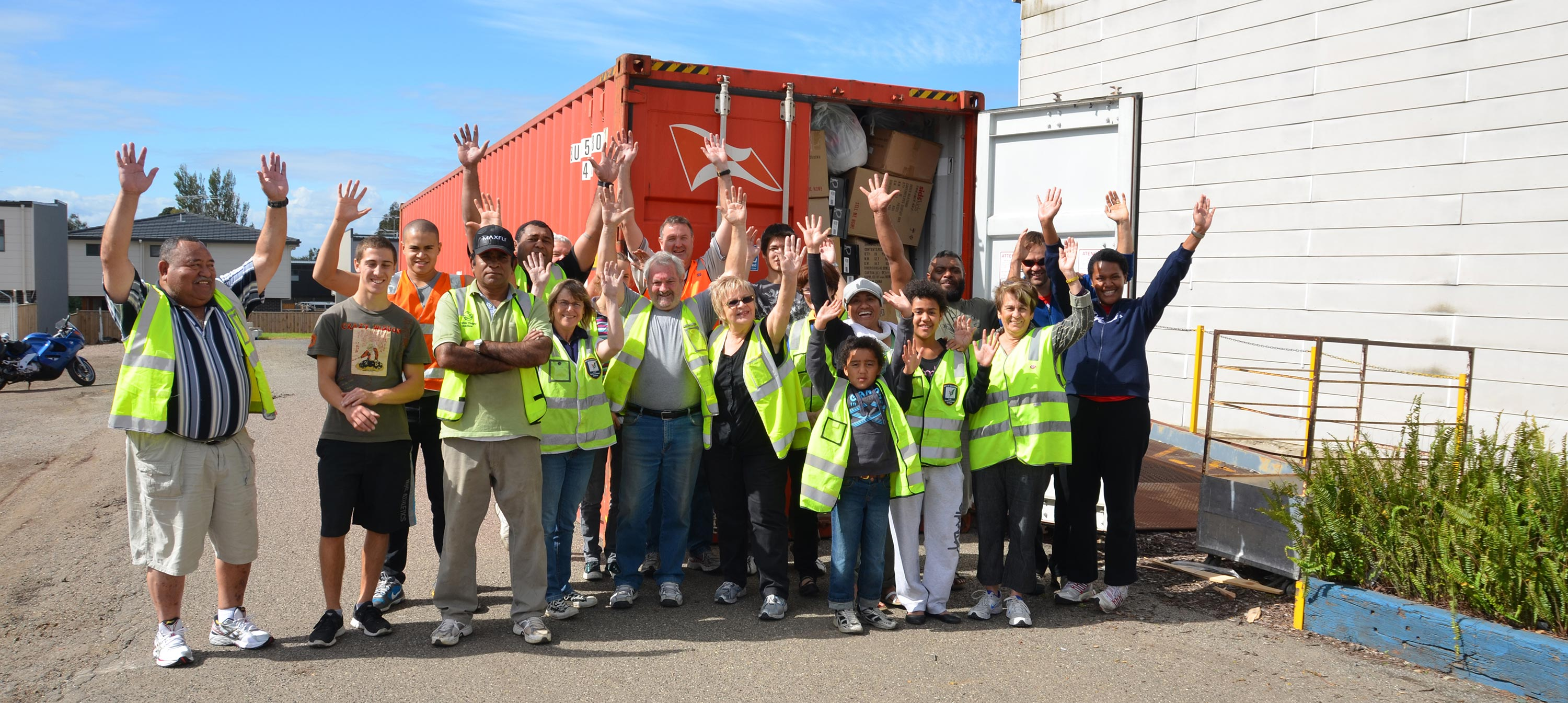 Packed Container outside DIK with volunteers