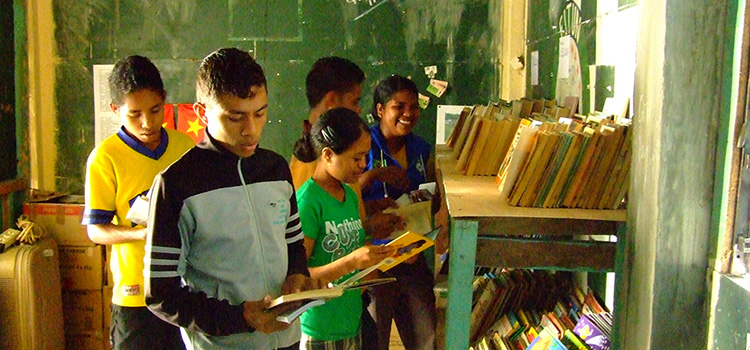Students reading donated books in library